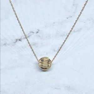 Solid 14k yellow gold folded single bead necklace